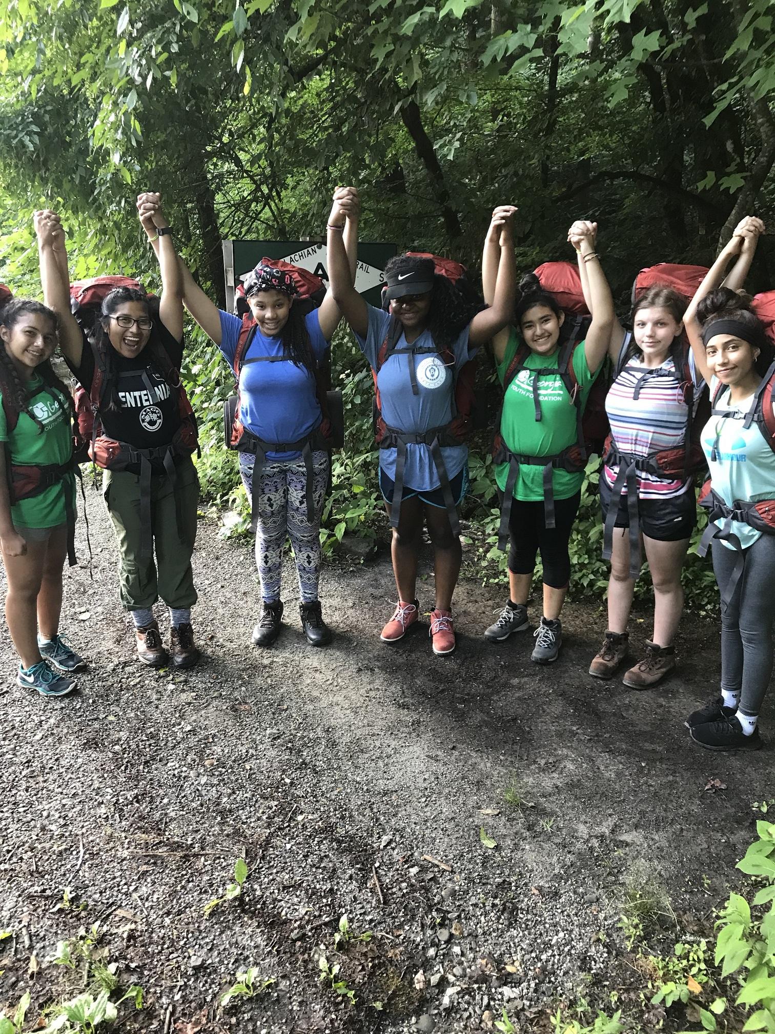 trek group holding hands